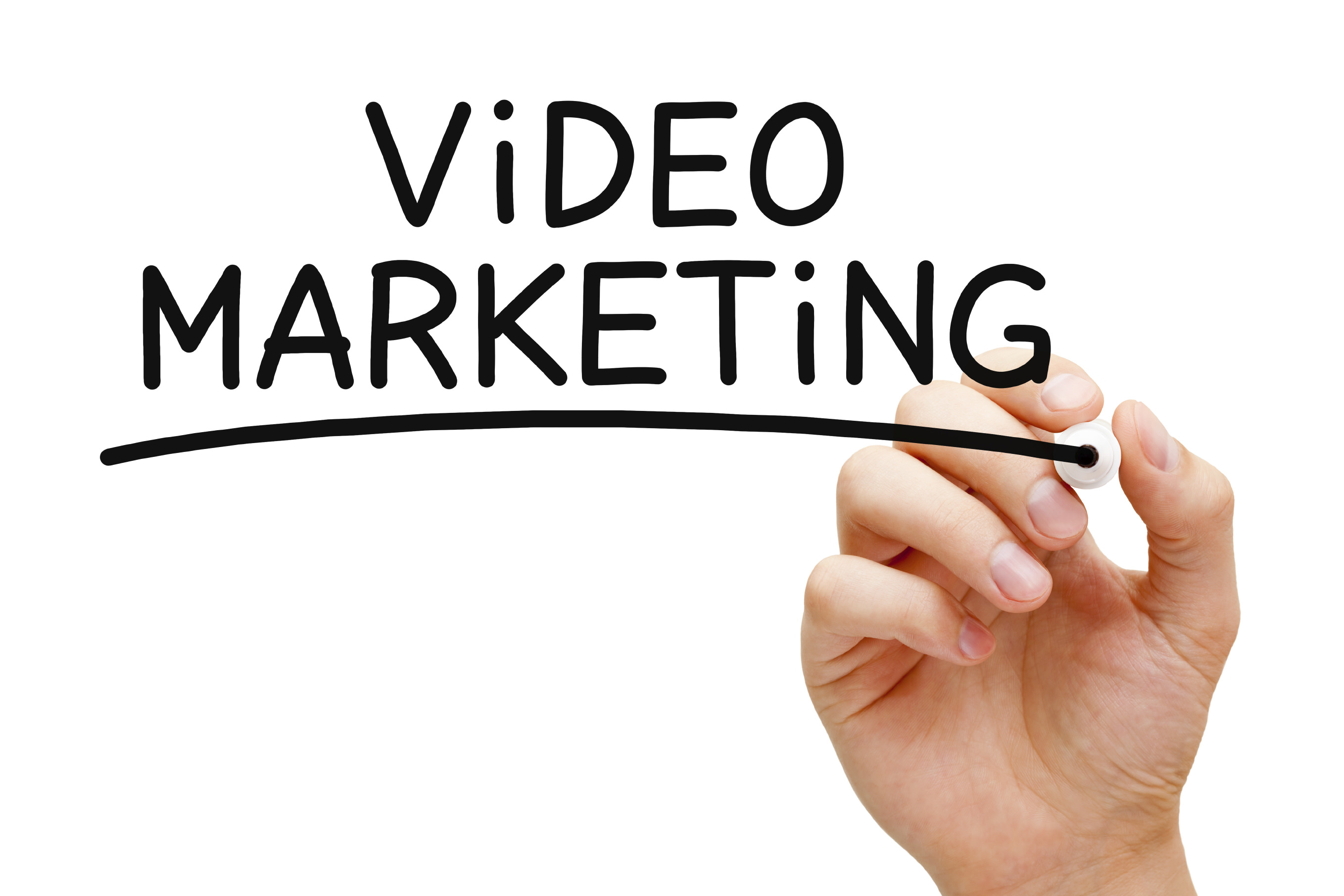 Hand writing Video Marketing with black marker on transparent wipe board.