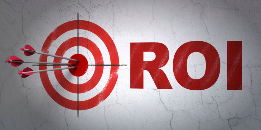 Business concept: target and ROI on wall background