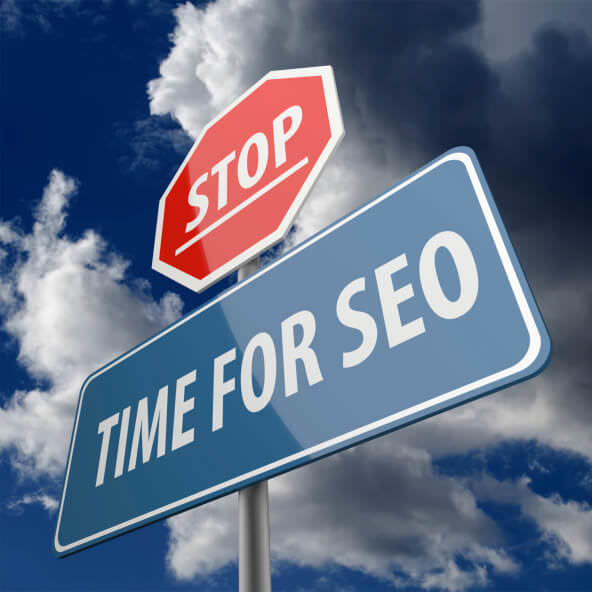 Stop and Time for SEO words on Road Sign