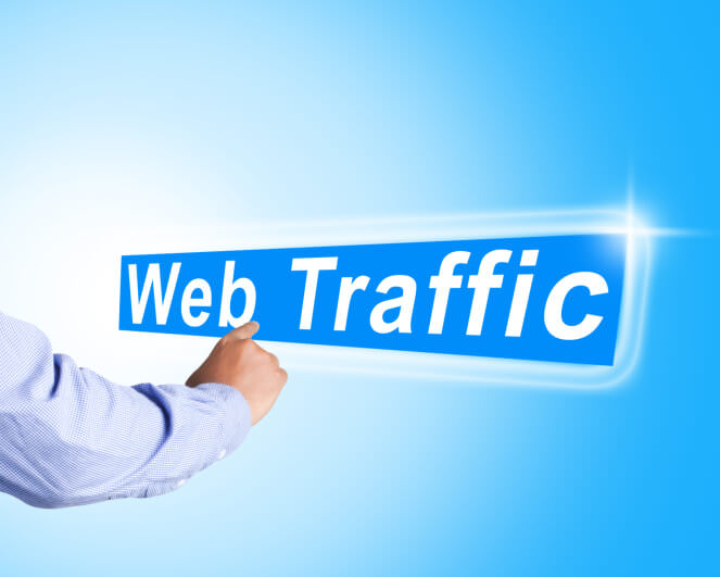 Business man hand touch web traffic text on abstract background