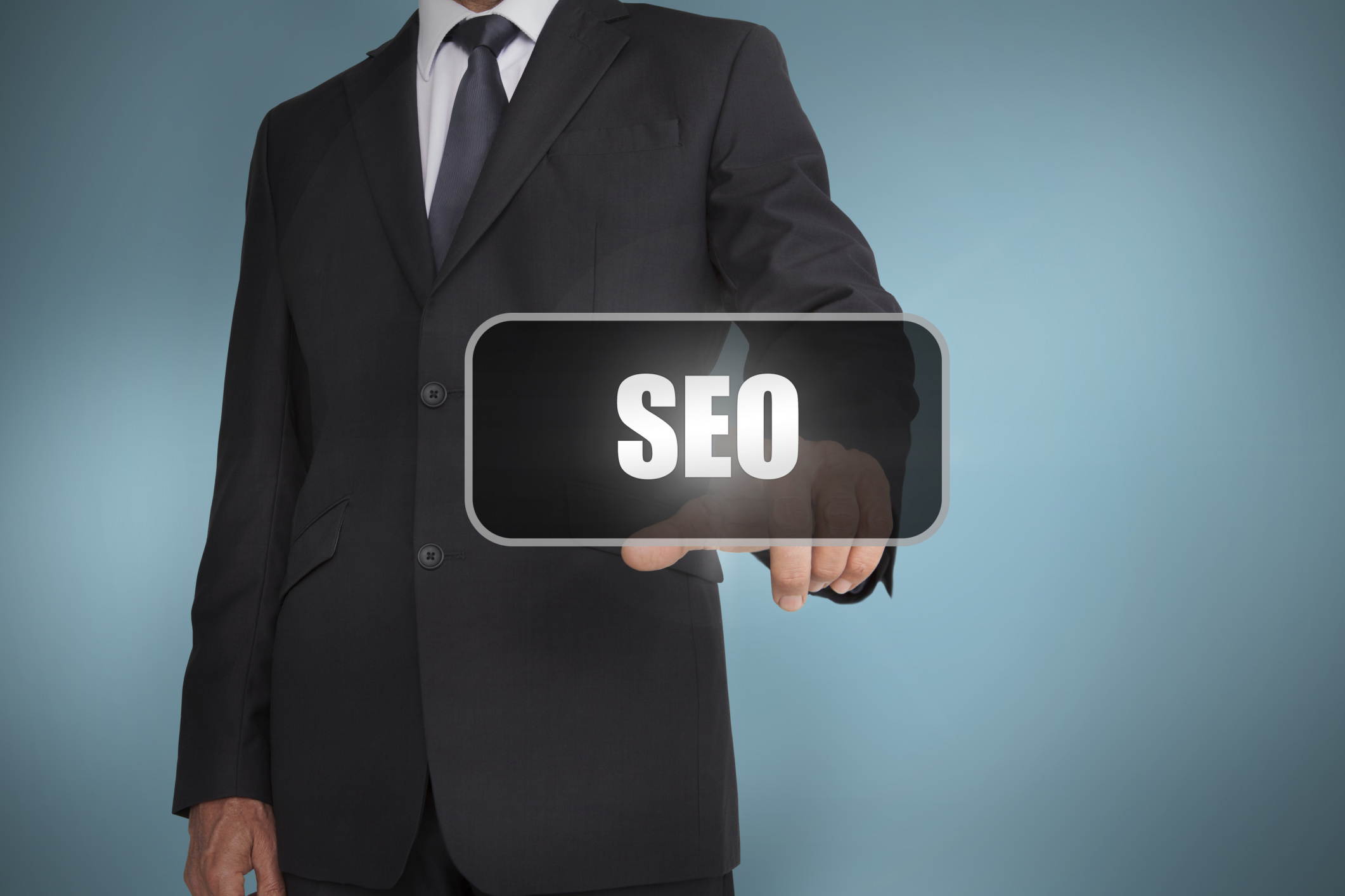 Businessman touching the word seo